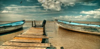 Boats and Jetty by Stephen Jay