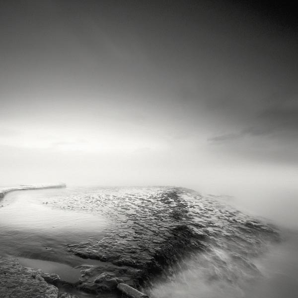B/W Long Exposure Sea and Rocks Photography by Nathan Wirth