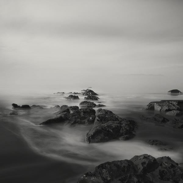 Black and White Long Exposure Sea and Rocks Photography by Nathan Wirth