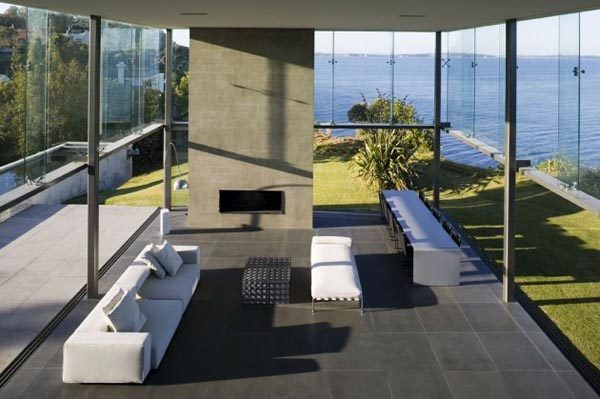 Inside the Cliff House with huge glass fronts by Fearon Hay Architects in Auckland, New Zealand