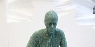 Seated Glass Figure by Daniel Arsham - made of broken glass and resin in 2012