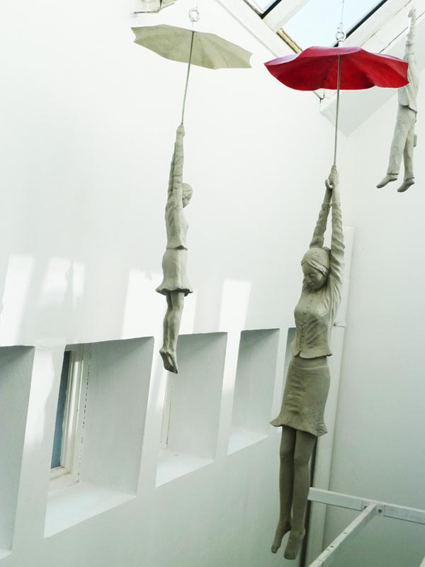 Cement Sculptures Dangling from Umbrellas