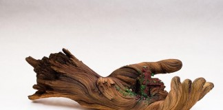 Cycle of Decay - ceramic hand sculpture looks like a tree branch