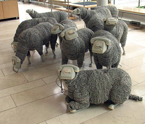 art installation consisting of 32 sheeps/phones by Jean Luc Cornec