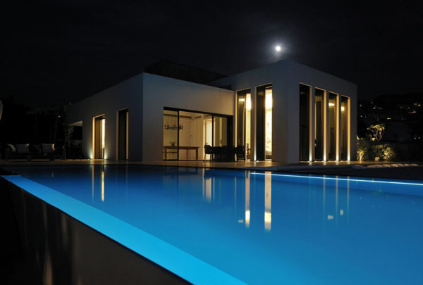 Pool and Beach House at Night