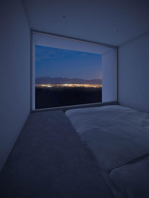 Bedroom of the Four Eyes House in Coachella Valley, California by Edward Ogosta Architecture