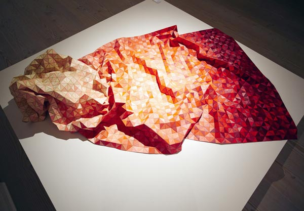 Blanket made of soft & flexible wood pieces by German textile designer Elisa Stotzyk