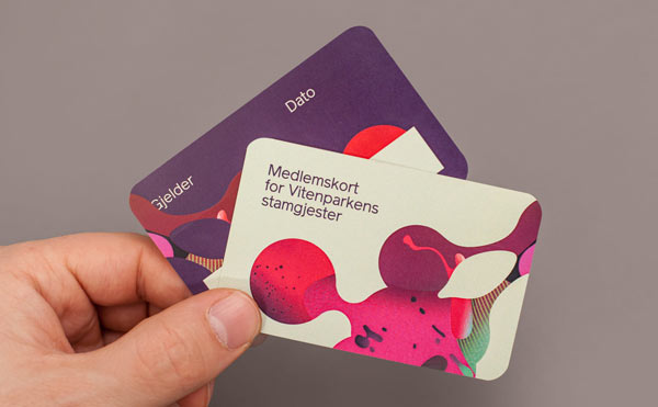 Printed Visual Identity with colorful illustrations.