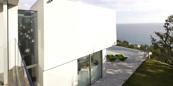 Modern architecture placed on a steep cliff overlooking the sea.
