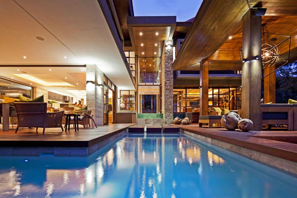 The architectural concept of the house includes several bodies of water.