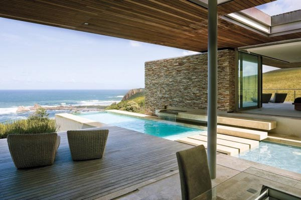 A covered terrace is overlooking the sea. Architectural design by Stefan Antoni Olmesdahl Truen Architects (SAOTA).