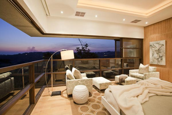 Also this luxurious bedroom provides a breathtaking view of the landscape.