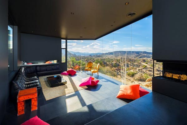 The living room of the house is characterized by modern interior design and a beautiful view of the landscape.