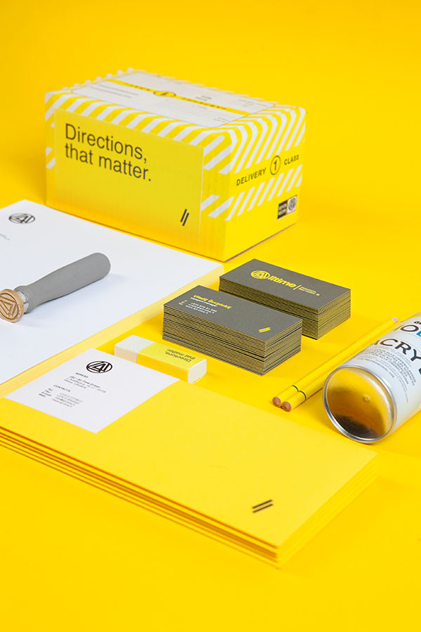 Corporate identity design based on yellow, grey and white colors.