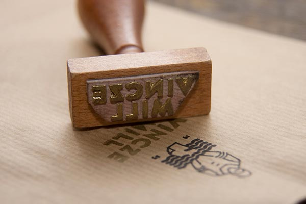 Stamp with golden typeface.