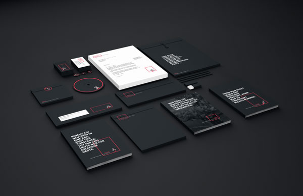 Stationery and communication materials - black and white in combination with a striking red color.