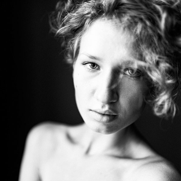 Portrait photography with a strong  contrast of light dark.