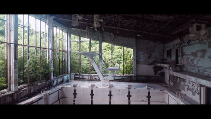 A dilapidated indoor swimming pool.