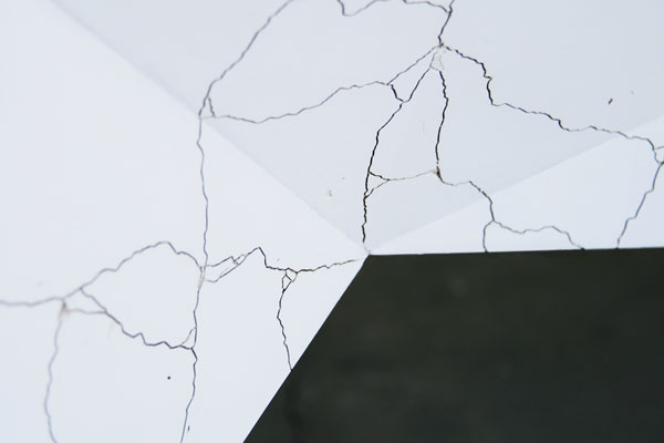Close up of the fine cracks in the surface.