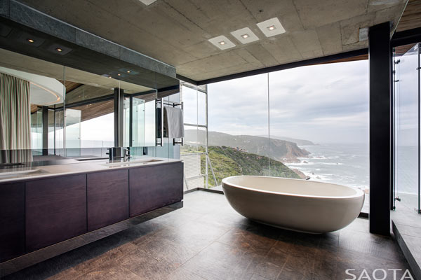 The beautiful bathroom interior design with large windows from the ceiling to the floor.