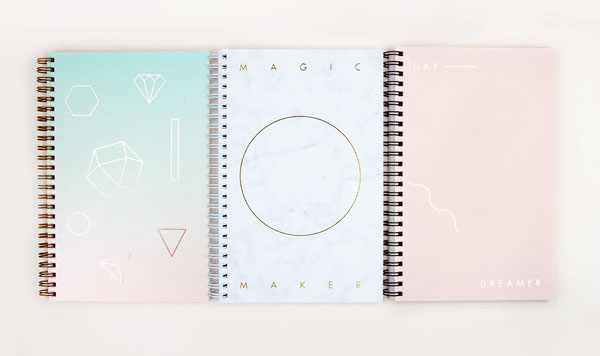 Notebooks with simple ornaments on the cover.