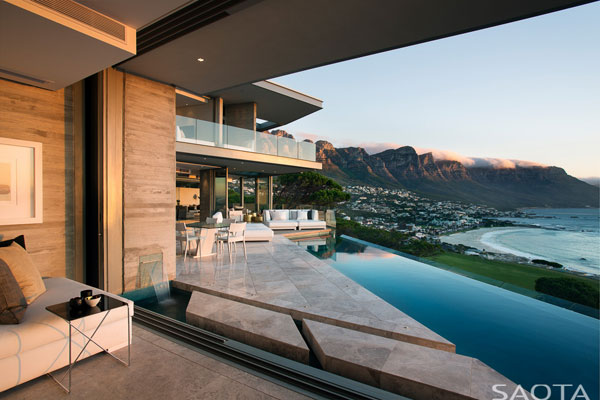 The dream house in Cape Town, South Africa provides breathtaking views of the coast and and the mountains to the side.