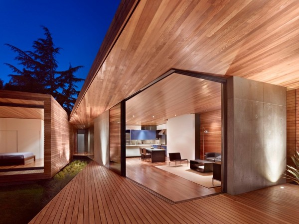 The architectural design is characterized by wood and simple forms.