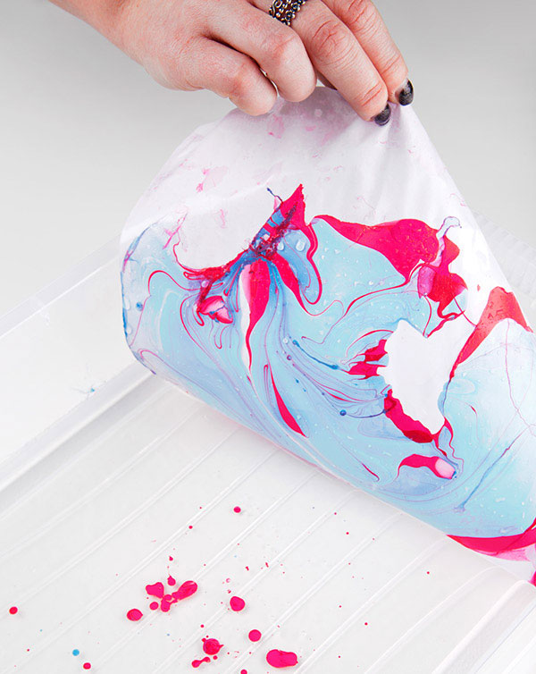 Colors and organic shapes created by swirling ink on water.