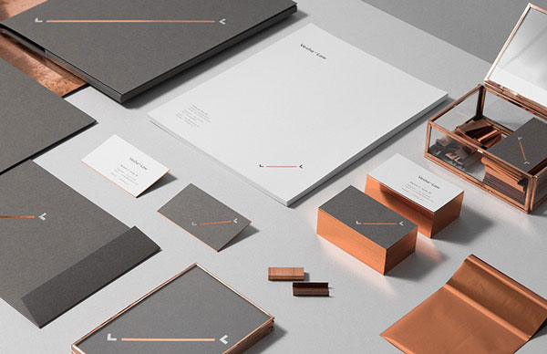 The complete brand identity for Vesha Law is based on a noble copper and silver finish.