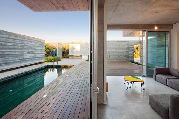 Pool area of the house - The home is characterized by a nice mix of wood and concrete.