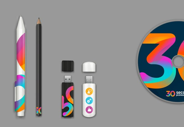 Some promotional items - CD, USB sticks, and pens.