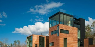 Cubic design with wood and glass facades.