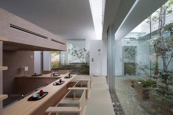 A large kitchen area with view of the plantings.