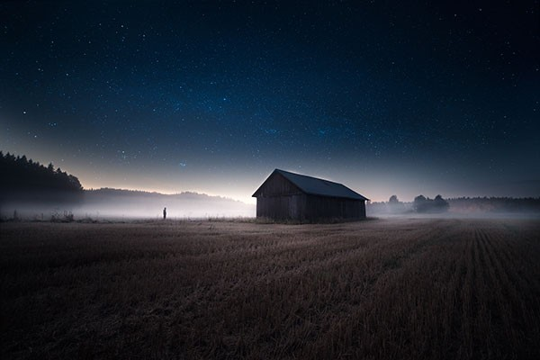 Stunning landspace photography with fog and a sky full of stars.