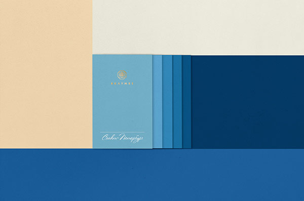 Business cards with different shades of blue.