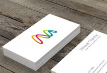Two-sided business cards with the colorful logo design on the front and the contact information on the back.