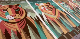 Close up of all four printed posters still on one printed sheet.