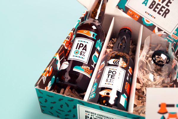Close up of the open package with included beer bottles and a glass.