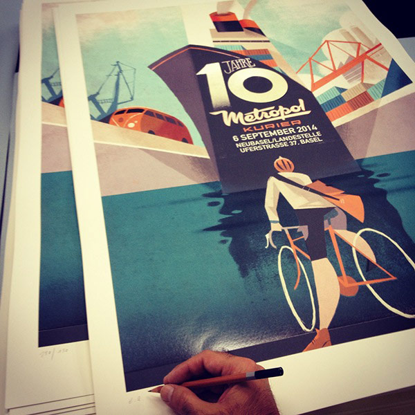 Illustrator Riccardo Guasco is signing some posters.