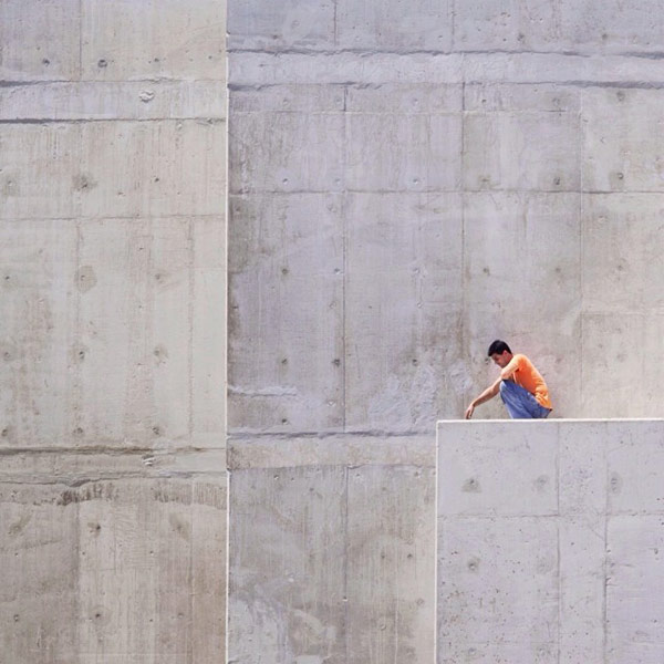 This image captures the pure minimalism of raw concrete and a lonely soul.