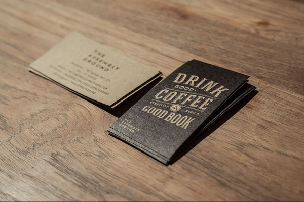 The vintage inspired business cards of the Assembly Store brand identity.