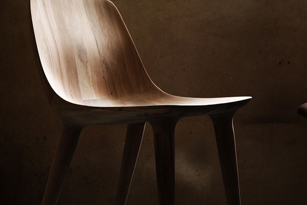 This beautiful piece of hand carved furniture was created of beech wood.