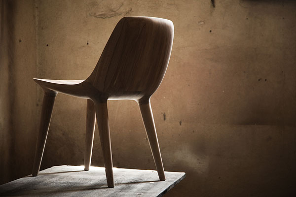 The backside of the chair shows harmonious and flowing forms.