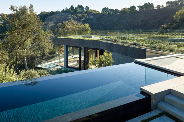 The luxurious house of glass and concrete provides great views.