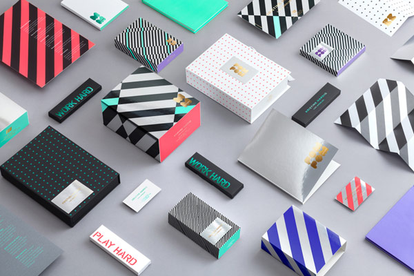 A colorful set of diverse branding materials, stationery, and packaging.