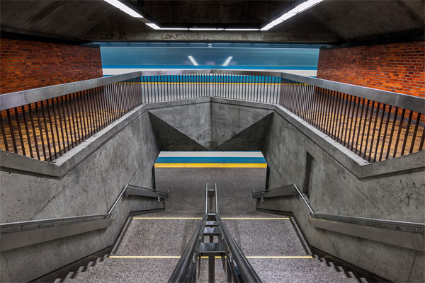 The symmetry of the staircase to the underground station.