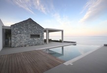 Villa Melana, a modern country house in local arcadian stone with great sea views.