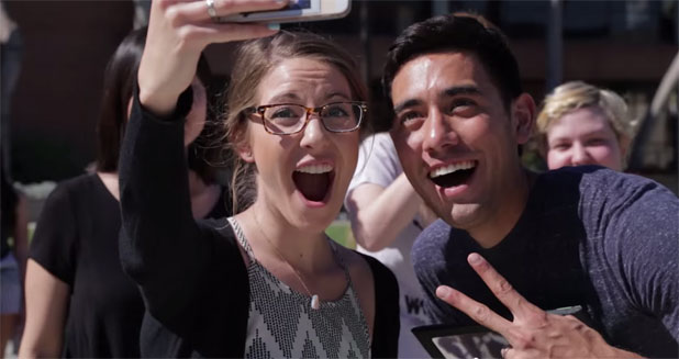 Enthusiastic people photograph him or take selfies with him Zach King.