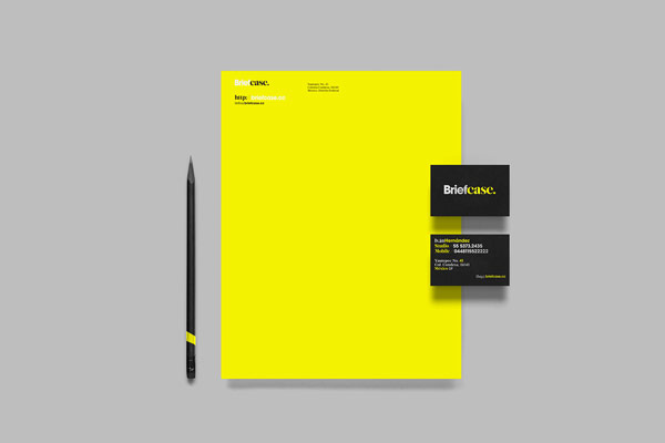Stationery and business cards of a brand identity, which is essentially reduced to black and yellow colors.