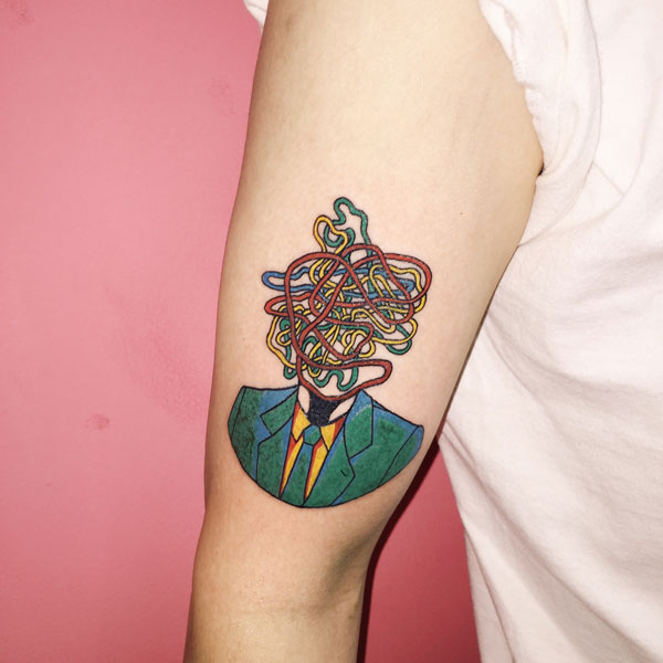 Colorful illustrative tattoo.